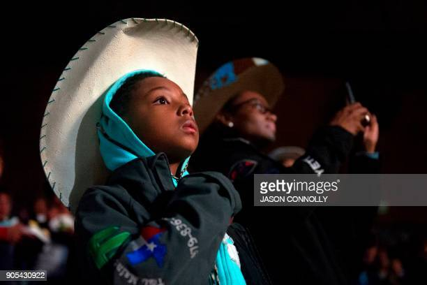 Kortnee Solomon of Prairie View Texas stands for the Black American National Anthem at the beginning of the MLK Jr African American Heritage Rodeo at...