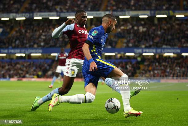 Kortney Hause of Aston Villa battles for possession with Hakim Ziyech of Chelsea during the Carabao Cup Third Round match between Chelsea and Aston...