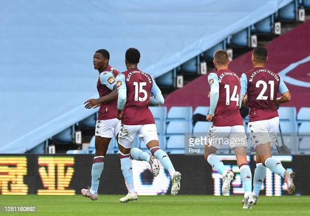 Kortney Hause of Aston Villa celebrates with his team after scoring his sides first goal during the Premier League match between Aston Villa and...