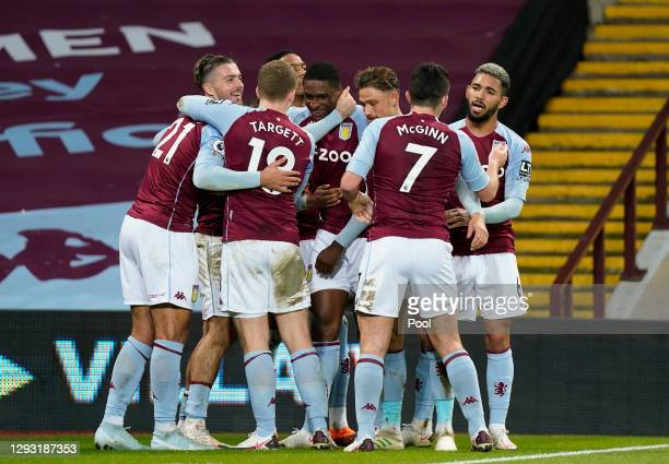 Kortney Hause of Aston Villa celebrates with teammates after scoring his team's second goal during the Premier League match between Aston Villa and...