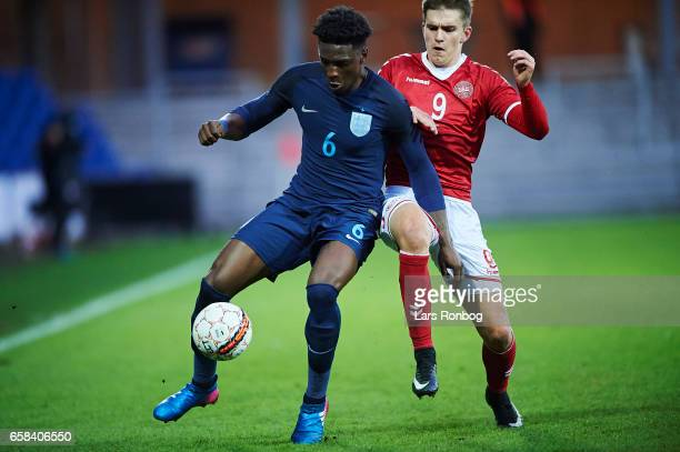 Kortney Hause of England U21 and Mikael Uhre of Denmark U21 compete for the ball during the U21 International friendly match between Denmark and...