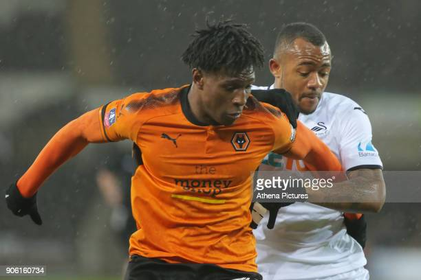 Kortney Hause of Wolverhampton Wanderers challenged by Jordan Ayew of Swansea City during the Emirates FA Cup match between Swansea and Wolverhampton...