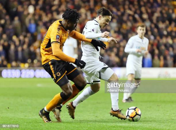 Kortney Hause of Wolverhampton Wanderers challenges Roque Mesa of Swansea City during the Emirates FA Cup match between Wolverhampton Wanderers and...