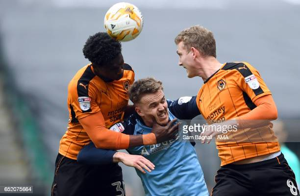Kortney Hause of Wolverhampton Wanderers grabs Danny Ward of Rotherham United and George Saville of Wolverhampton Wanderers during the Sky Bet...