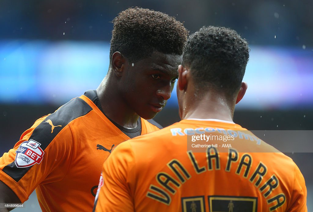 Kortney Hause speaks to Rajiv van La Parra of Wolverhampton Wanderers during the Sky Bet Championship match between Cardiff City and Wolverhampton Wanderers at Cardiff City Stadium on August 22, 2015 in Cardiff, Wales.