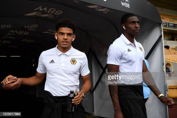 Kortney Hayse of Wolverhampton Wanderers and Morgan GibbsWhite of Wolverhampton Wanderers walk out onto the pitch prior to the Premier League match...