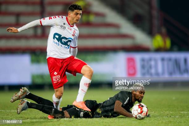 Kortrijk's Larry Azouni and Eupen's Jonathan Bolingi fight for the ball during a soccer game between Jupiler Pro League clubs KV Kortrijk and KAS...