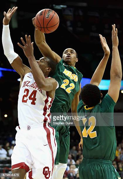 Kory Brown of the North Dakota State Bison blocks a shot by Buddy Hield of the Oklahoma Sooners during the second round of the 2014 NCAA Men's...