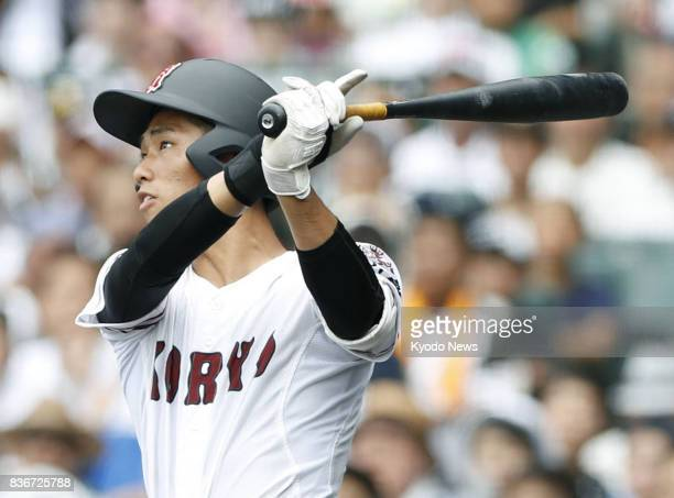 Koryo catcher Shosei Nakamura hits a solo home run in the fifth inning of the team's 129 semifinal victory over Tenri at the national high school...