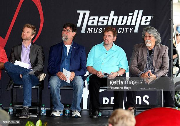 Kos Weaver from BMG Nashville and Teddy Gentry Jeff Cook and Randy Owen from Alabama awaits their introduction before receiving a star on the Music...