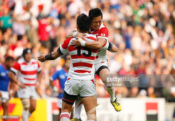 Kosei Ono and Ayumu Goromaru of Japan celebrate victory after the 2015 Rugby World Cup Pool B match between Samoa and Japan at Stadium mk on October...