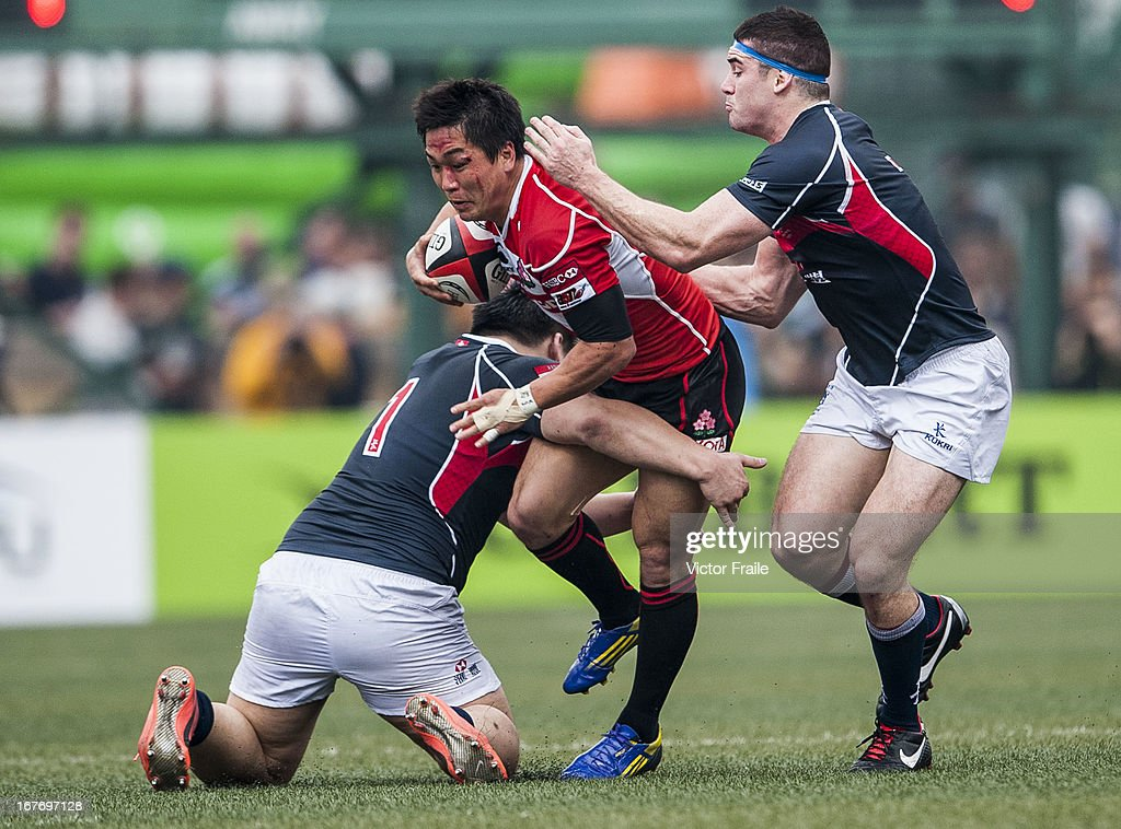 Kosei Ono of Japan fights for the ball against Hong Kong players during their Asian 5 Nations Top 5 Division match at the Hong Kong Football CLub on April 27, 2013 in Hong Kong, China.