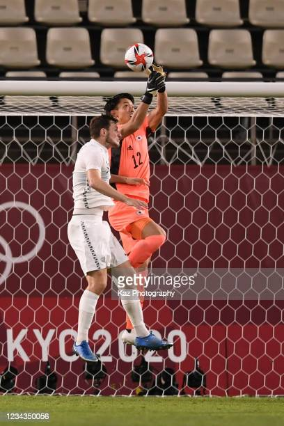 Kosei Tani of Japan catches the ball during the Men's Quarter Final match on day eight of the Tokyo 2020 Olympic Games at Kashima Stadium on July 31,...