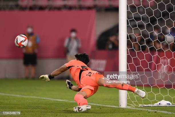 Kosei Tani of Japan saves the penalty kick at Penalty Shoot Out during the Men's Quarter Final match on day eight of the Tokyo 2020 Olympic Games at...