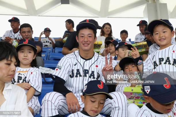 Kosei Yoshida of Samurai Japan U18 poses with participants at a lunch before the Samurai Japan Kids Academy prior to the game between Samurai Japan...