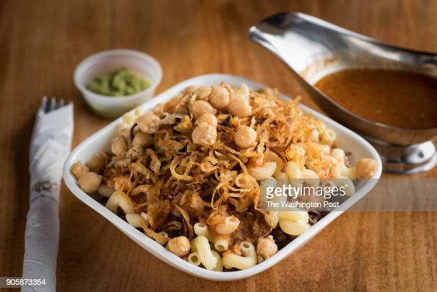 Koshary lentils rice pasta and a spicy tomato sauce topped with chickpeas and sweet caramelized onions at Fava Pot in Falls Church VA January 11 2018