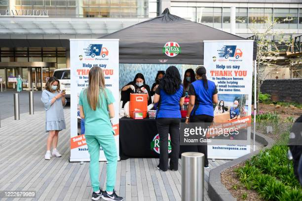 Kosher Response station serves Rita's Italian Ice to medical workers outside NYU Langone Health hospital during the coronavirus pandemic on May 3...