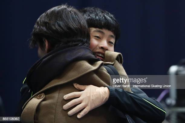 Koshiro Shimada of Japan celebrate with his coach after the Junior Men Short Program during day two of the ISU Junior Grand Prix of Figure Skating at...