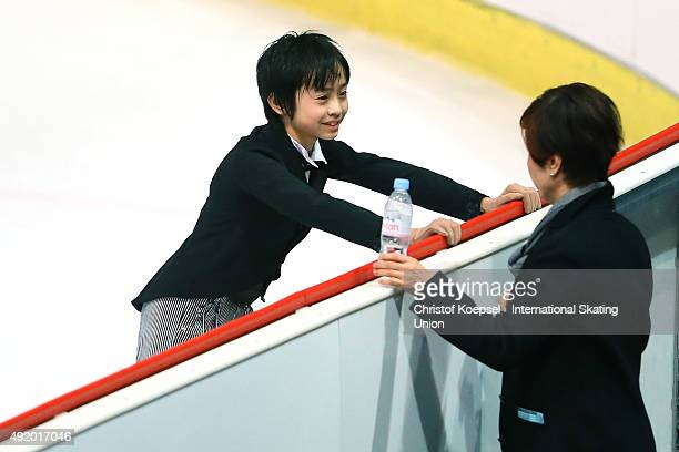 Koshiro Shimada of Japan speask to his coach Kotoe Nagasawa prior to the junior men free skating of the ISU Junior Grand Prix at Dom Sportova on...