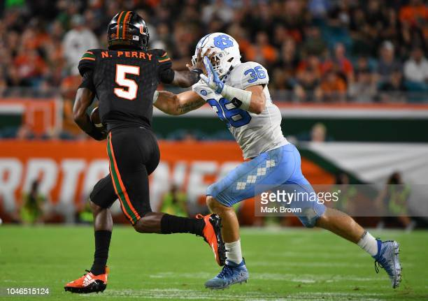 Kosi Perry of the Miami Hurricanes runs with the ball against the North Carolina Tar Heels at Hard Rock Stadium on September 27 2018 in Miami Florida