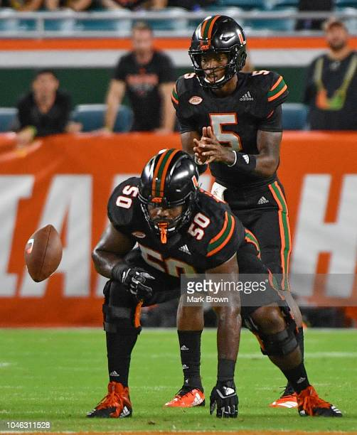 Kosi Perry of the Miami Hurricanes under center during the game against the North Carolina Tar Heels at Hard Rock Stadium on September 27 2018 in...