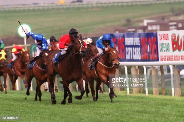 Kosmic Lady ridden by GBaker leads from Indian Sun ridden by Pat Eddery and Jetstream Flyer ridden by Jason Tate