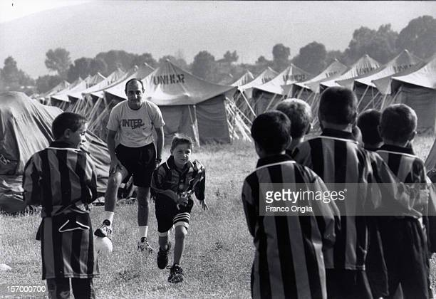 Kosovan boys play football during an Intercampus training session in a refugees Camp installed during the war in Kosovo on June 27 1998 in Saranda...