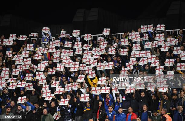 Kosovan fans hold up England flags during the UEFA Euro 2020 Qualifier between Kosovo and England at the Pristina City Stadium on November 17 2019 in...