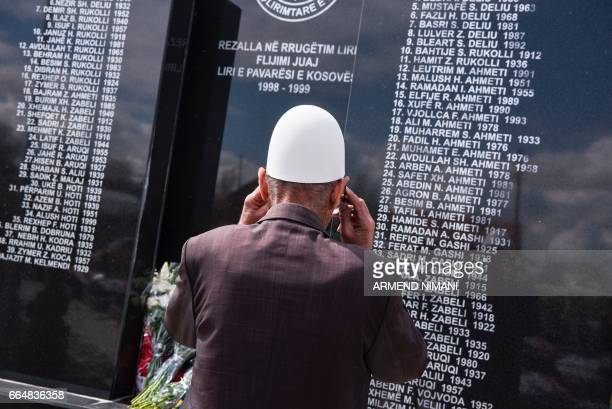 A Kosovan looks on a memorial stone the names of relatives who were killed during the Kosovo war in 1999 during a ceremony on April 5 2017 marking...