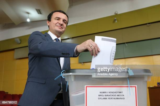 Kosovan Prime Minister candidate from the opposition party 'Vetevendosje' Albin Kurti casts his vote at a polling station during a snap parliamentary...