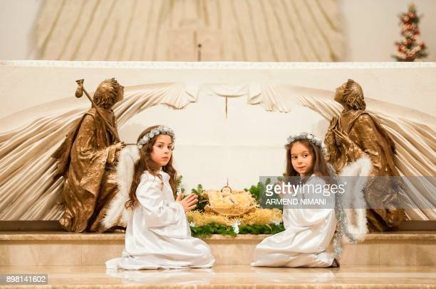 Kosovar children dressed as angels pray prior to the Christmas mass eve marking the birth of Jesus Christ on December 24 2017 at the Mother Teresa...