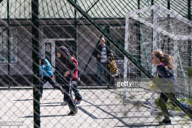 Kosovar children returned from Syria play in the compound of the foreign detention center in the village of Vranidoll Kosovo on April 20 2019 Kosovo...