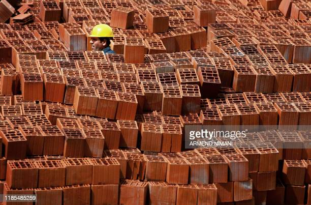 A Kosovar employee works on a construction site near Pristina on April 15 2008 AFP PHOTO / ARMEND NIMANI
