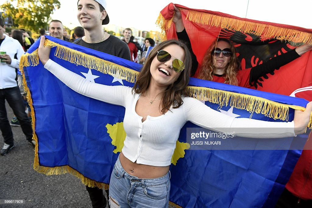 Kosovar fans cheer prior to the WC 2018 football qualification match between (group I) Finland vs Kosovo in Turku on September 5, 2016. / AFP / Lehtikuva / Jussi Nukari / Finland OUT