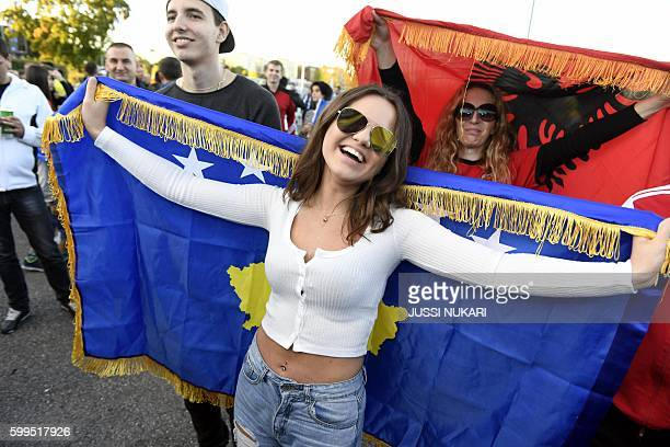 Kosovar fans cheer prior to the WC 2018 football qualification match between Finland vs Kosovo in Turku on September 5 2016 / AFP / Lehtikuva / Jussi...