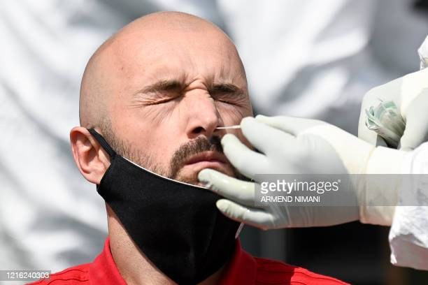 A Kosovar football referee gets tested for COVID19 at the Fadil Vokrri Stadium in Pristina on May 30 2020 Since March 14 all sporting events have...