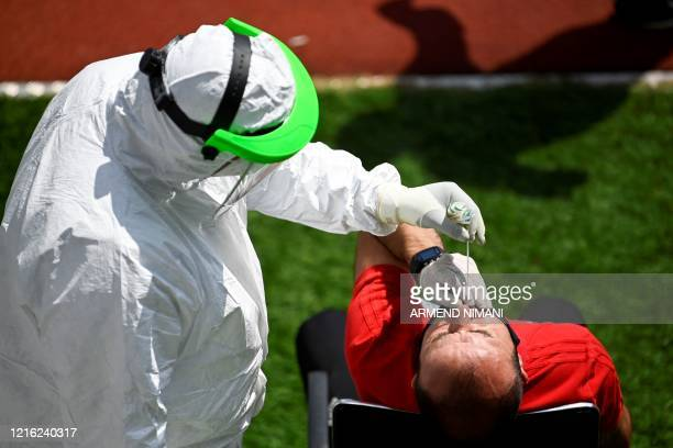 Kosovar football referee gets tested for COVID19 at the Fadil Vokrri Stadium in Pristina on May 30 2020 Since March 14 all sporting events have been...