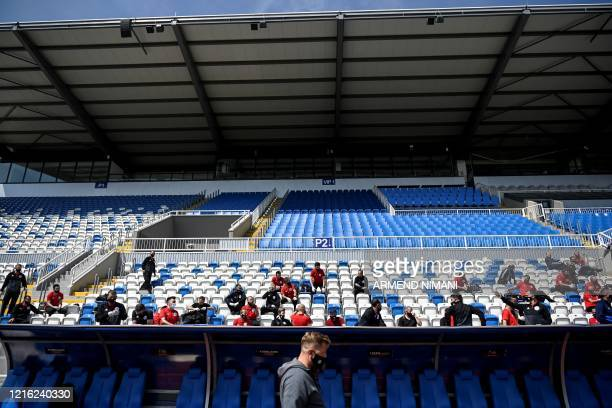 Kosovar football referees sit and wait to get tested for COVID19 at the Fadil Vokrri Stadium in Pristina on May 30 2020 Since March 14 all sporting...