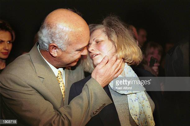 Kosovar human rights activist Flora Brovina is embraced by her husband as she crosses the boundary from Serbia to Kosovo November 1 2000 after her...