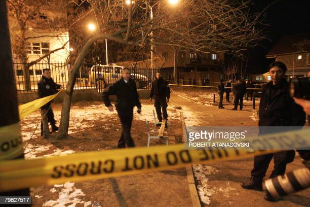 Kosovar police secure the area in front of the OSCE mission building in the ethnically divided Kosovo town of Mitrovica February 18 2008 An explosion...