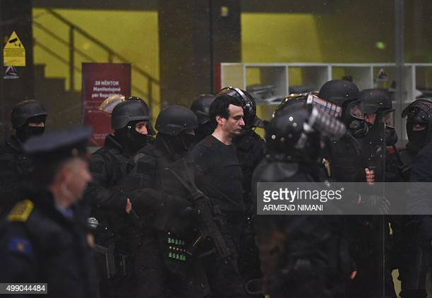 Kosovar policemen detain opposition lawmaker Albin Kurti at the Vetevendosje headquarters after several thousand of protesters gathered in downtown...