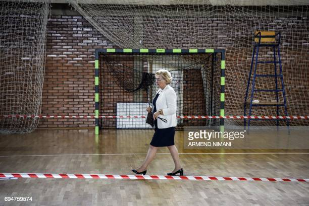 A Kosovar woman leaves a polling station in Pristina during early parliamentary elections in Kosovo on June 11 2017 Kosovo began voting for a new...