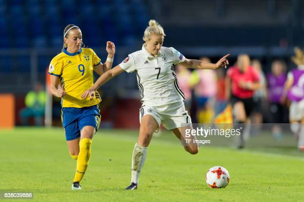 Kosovare Asllani of Sweden and Carolin Simon of Germany battle for the ball l during the Group B match between Germany and Sweden during the UEFA...