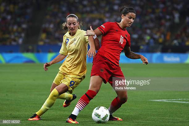 Kosovare Asllani of Sweden and Dzsenifer Marozsan of Germany challenge for the ball during the Women's Olympic Gold Medal match between Sweden and...