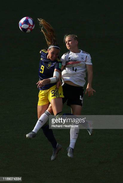 Kosovare Asllani of Sweden and Leonie Maier of Germany jump for the ball during the 2019 FIFA Women's World Cup France Quarter Final match between...