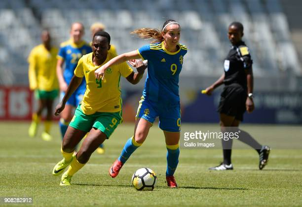 Kosovare Asllani of Sweden and Sduduzo Dlamini of South Africa during the International Women's Friendly match between South Africa and Sweden at...
