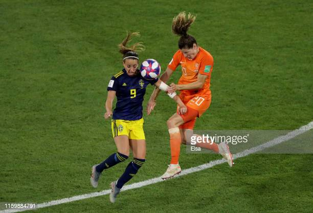 Kosovare Asllani of Sweden battles for possession with Dominique Bloodworth of the Netherlands during the 2019 FIFA Women's World Cup France Semi...
