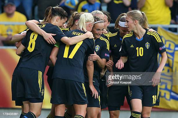 Kosovare Asllani of Sweden celebrates the third goal with her team mates during the UEFA Women's EURO 2013 Group A match between Finland and Sweden...