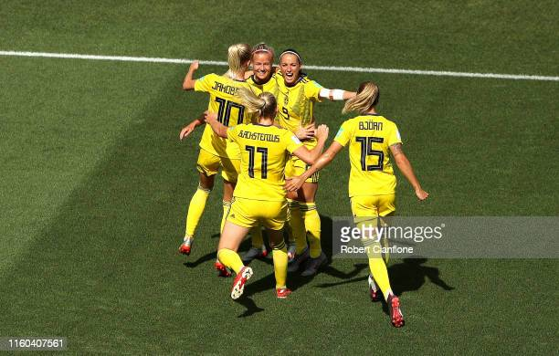 Kosovare Asllani of Sweden celebrates with teammates after scoring her team's first goal during the 2019 FIFA Women's World Cup France 3rd Place...