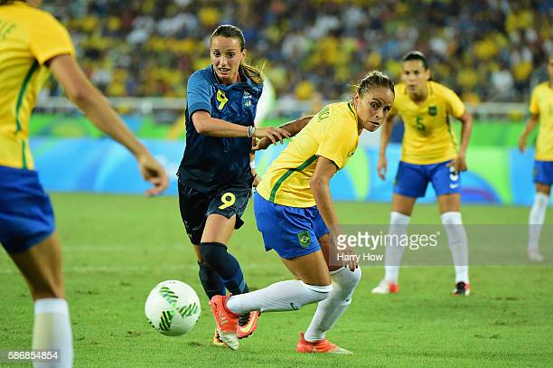 Kosovare Asllani of Sweden fights for the ball with Monica of Brazil during the Women's Group E first round match between Brazil and Sweden on Day 1...